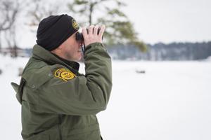 image of border patrol agent with binoculars