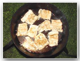 image of pike pieces sizzling in fry pan