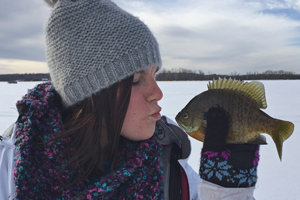 image of jo bellamy kissing bluegill
