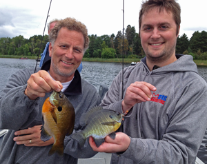 image of anglers with bluegills