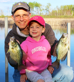 image of Jason Halfen and youn angler with nice crappies