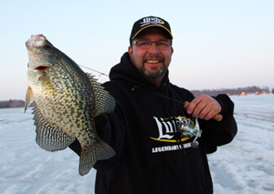 image of Paul Fournier with Crappie on ice