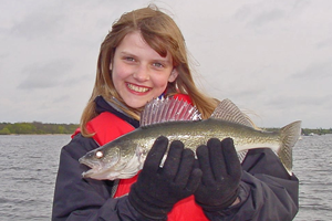 image of young lady with nice walleye