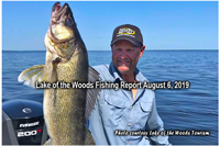 image of angler with gigantic walleye