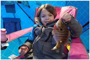 image of kid with big sunfish