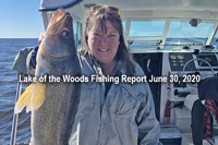 image of woman with trophy walleye caught on lake of the woods