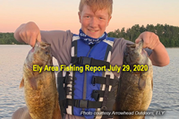 image of young man with 2 nice smallmouth bass