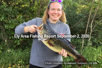 image of woman holding big largemouth bass