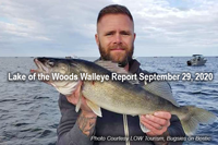 image of man with nice lake of the woods walleye