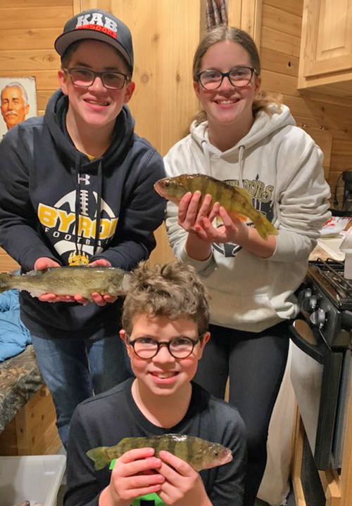 image of Natalie, Oliver and Andy with mixed bag of walleye and perch