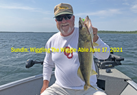 image of Larry Lashley with nice walleye caught using wiggle worms
