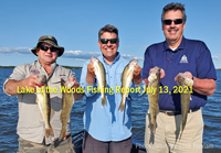 image of men on boat showing off lake of the woods walleyes