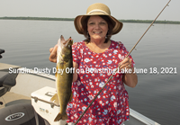 image of The Hippie Chick with nice walleye caught on Bowstring Lake