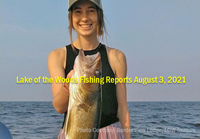 image of woman holding huge walleye caught on Lake of the Woods