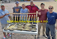 image of anglers posing with limits of walleyes