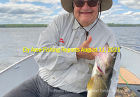 image of angler with big walleye caught in the ely mn area