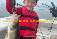 image of young boy holding nice walleye caught on Border View Charter Boat