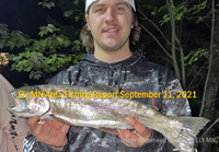 image of young angler holding nice trout