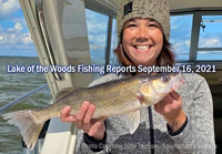 image of woman with nice walleye caught on lake of the woods charter boat