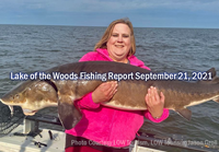 image of woman with huge sturgeon caught on lake of the woods
