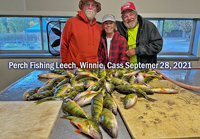 image of Greg, along with Keith and Diane Eberhardt and their catch of jumbo perch