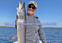 image of woman with big pike caught in the Ely MN region