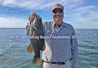 image of Tom with nice smallmouth bass caught on Leech Lake