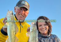 Image of The Hippie Chick and Jeff Sundin with nice walleye double