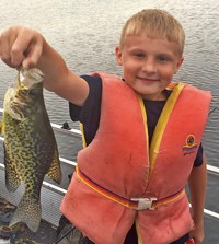 image of Gavin holding nice crappie