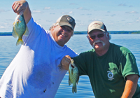 image of mike and todd clark with lake of the woods crappies