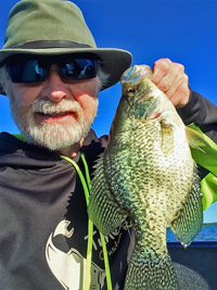 image of greg clusiau with big bowstring lake crappie