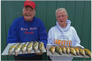 image of karen and kyle reynolds with perch and walleye