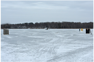 image of spearing shelters on the ice