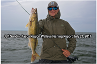 image of angler holding big walleye