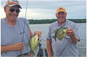 image of bob slager and jeff sundin with big crappies