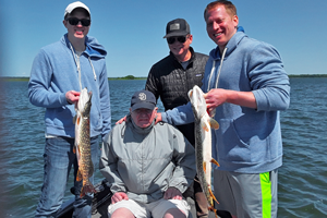 image of kelly family with northern pike