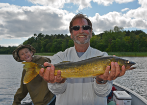 image of angler with big walleye