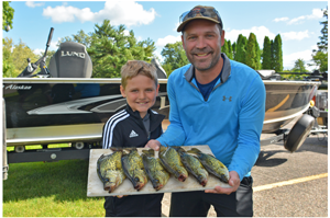 image of geoff and garrett glasrud with nice crappies